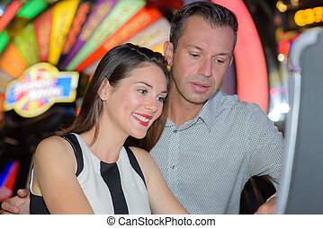 Middle aged couple in casino