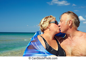 Middle aged couple kissing on the vacation