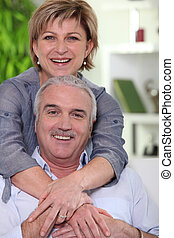 middle-aged couple looking happy