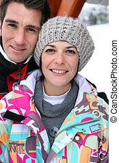 Middle-aged couple on a skiing holiday together
