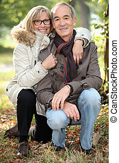 Middle-aged couple walking in the park