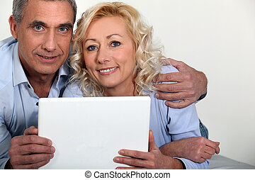 Middle-aged couple with computer