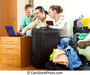 Middle-aged couple with teenage son choosing the resort on the i