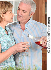 Middle-aged couple with wine