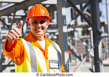middle aged electrician giving thumb up