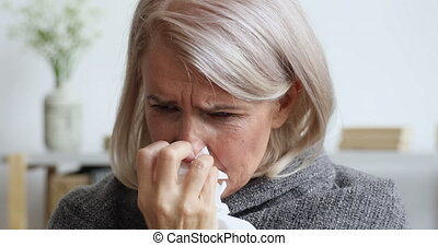 Middle aged female retiree caught cold, sneezing. - Head ...