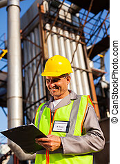 middle aged heavy industry worker in plant - happy middle...