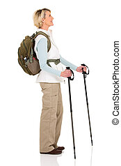middle aged hiker with trekking poles