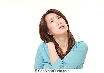 middle aged Japanese woman suffers from neck ache