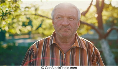 Middle aged man at sunset - Portrait of middle aged man at...