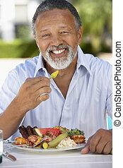 Middle Aged Man Dining Al Fresco