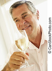 Middle Aged Man Drinking A Glass Of Wine
