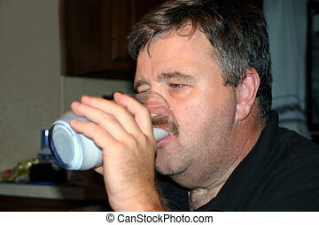 Middle-Aged Man Drinking Milk