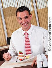 middle aged man eating dessert