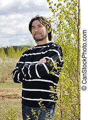 Middle-aged man in a birch grove