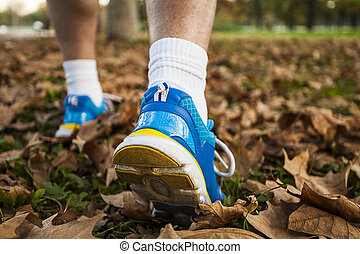 Middle-aged man in running shoes