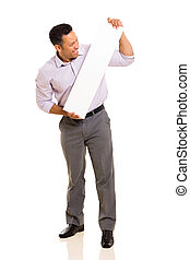 middle aged man looking at blank white board