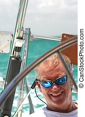 Middle aged Man on Sailboat