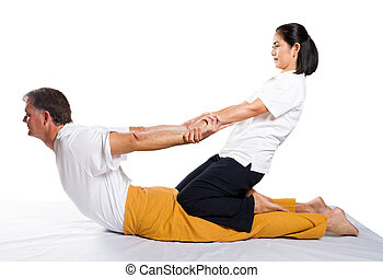 traditional Thai massage - middle aged man receiving massage...