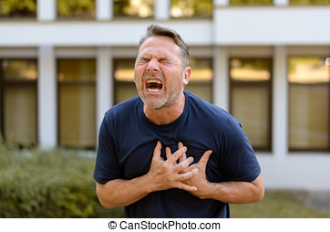 Middle-aged man suffering a heart attack