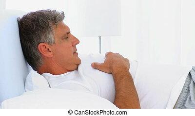 Middle aged man waking up