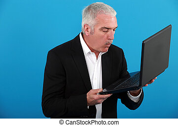 middle-aged man with laptop