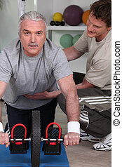 Middle-aged man with personal trainer