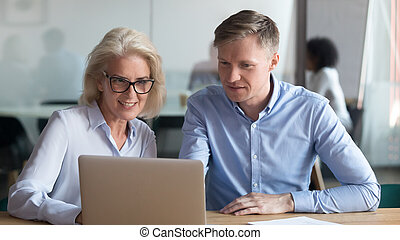 Middle aged manager make business offer to client on laptop