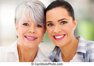 middle aged mother and young daughter