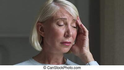 Middle aged nervous worrying woman suffering from strong ...