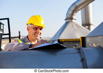 middle aged oil chemical industry technician working...