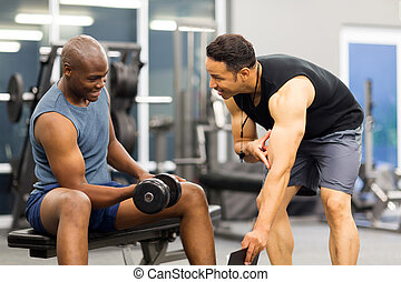 middle aged personal trainer training client