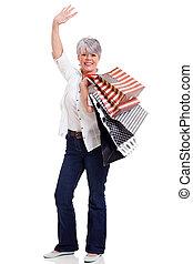 middle aged shopper waving goodbye