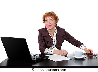 Middle-aged woman at the table, a laptop