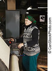 Middle-aged woman at work sideview