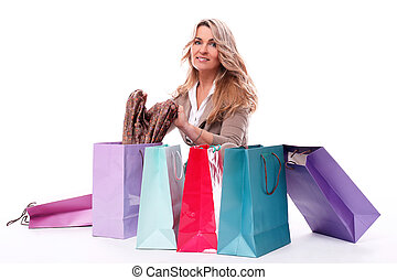 Middle aged woman checking her shopping bags