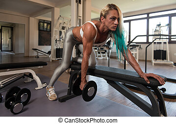 Middle Aged Woman Doing Back Exercises - Middle Aged Woman...