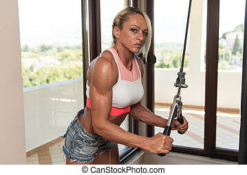 Middle Aged Woman Doing Exercise For Triceps - Middle Aged...