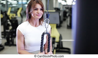 middle-aged woman doing exercise in the gym