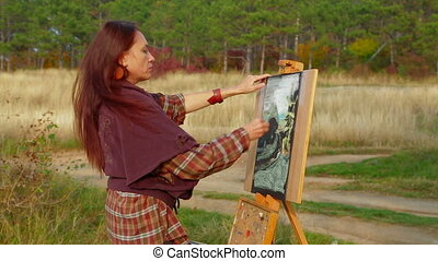Middle Aged Woman Drawing A Picture Plein Air