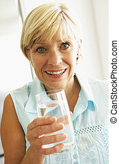 Middle Aged Woman Drinking A Glass Of Water