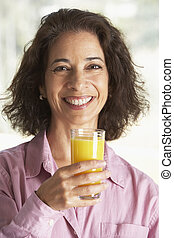 Middle Aged Woman Drinking Fresh Orange Juice