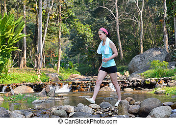 Middle aged woman exercise by walking in the park