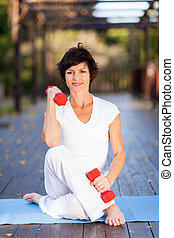 middle aged woman exercise - active middle aged woman...