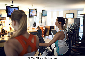 Middle-aged woman exercising in gym