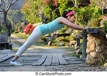 Middle aged woman exercising in the park