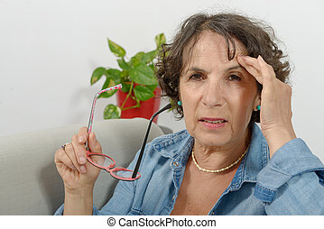 middle-aged woman has headache