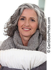Middle-aged woman hugging pillow
