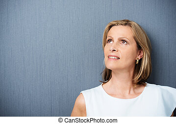 Middle-aged woman lost in thought