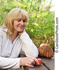 Middle aged woman outdoors